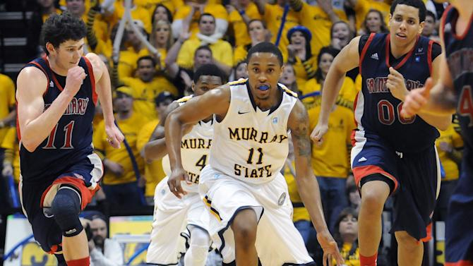 Murray State's Donte Poole, center, breaks away from St. Mary's Clint Steindl, left, Brad Waldow (00) and Matthew Dellavedova, right, as Murray State's Latreze Mushatt (4) trails the play during the second half of an NCAA college basketball game on Saturday, Feb. 18, 2012, in Murray, Ky. Murray State won 65-51. (AP Photo/Stephen Lance Dennee)
