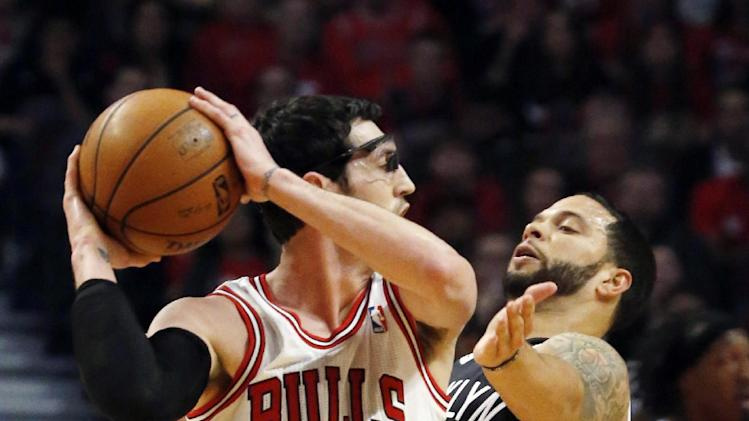 Brooklyn Nets guard Deron Williams, right, pressure Chicago Bulls guard Kirk Hinrich during the first half of Game 3 of their first-round NBA basketball playoff series, Thursday, April 25, 2013, in Chicago. (AP Photo/Charles Rex Arbogast)