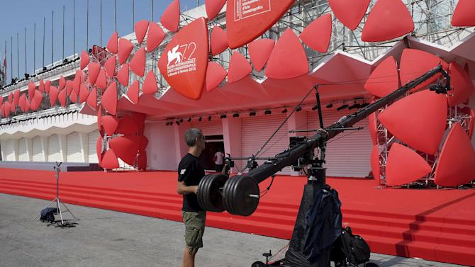 Technician checks a camera dolly in front the entrance of the venue for the 72nd Venice Film Festival in Venice