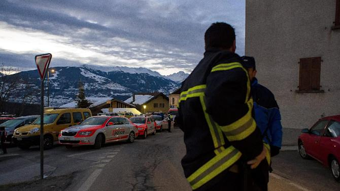 Police patrol in the village of Daillon after a shooting, in Switzerland, early Thursday, Jan. 3, 2013. A man shot and killed three people and wounded another two in a Swiss village, and was then arrested by officers who shot and injured him, police said Thursday. Police in the southern canton (state) of Valais said they were alerted to the shooting in the village of Daillon just before 9 p.m. (20:00GMT) Wednesday. Three of the victims died at the scene and the two injured people were taken to hospitals. A police statement early Thursday gave no detail on their injuries. (AP Photos/Keystone, Olivier Maire)