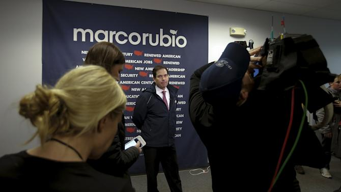 Republican presidential candidate Marco Rubio gives an interview following a campaign event in Manchester, New Hampshire