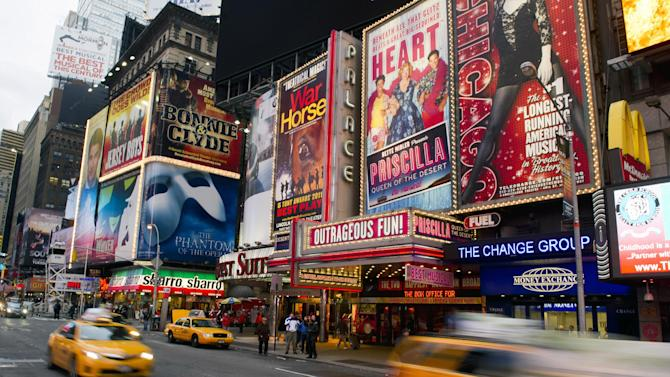 FILE - This Jan. 19, 2012 file photo shows billboards advertising Broadway shows in Times Square, in New York. Superstorm Sandy, which darkened Broadway while smashing into New York City last week, predictably ravaged the box offices around Times Square, with shows losing more than $6 million from the previous week.  (AP Photo/Charles Sykes, file)
