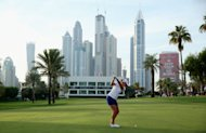 DUBAI, UNITED ARAB EMIRATES - DECEMBER 06: Stacey Lewis of the USA plays her second shot into the 16th green during the third round of the 2013 Omega Dubai Ladies Masters on the Majilis Course at the Emirates Golf Club on December 6, 2013 in Dubai, United Arab Emirates. (Photo by Warren Little/Getty Images)