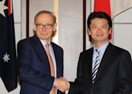 Australian Foreign Minister Bob Carr (left) shakes hands with his Japanese counterpart Koichiro Gemba at a signing ceremony in Tokyo. Japan and Australia have signed an agreement that will allow them to share intelligence as the Asia-Pacific region adapts to the rising power of China