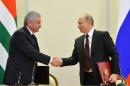 Russian President Vladimir Putin, right, and leader of Georgia's breakaway province of Abkhazia Raul Khadzhimba shake hands at a signing ceremony in the Bocharov Ruchei residence in Sochi, Russia, Monday, Nov. 24, 2014. Russia further tightened its control over Georgia's breakaway province of Abkhazia on Monday with a new treaty envisaging closer military and economic ties, a move that has drawn outrage in Georgia. (AP Photo/RIA-Novosti, Alexei Druzhinin, Presidential Press Service)