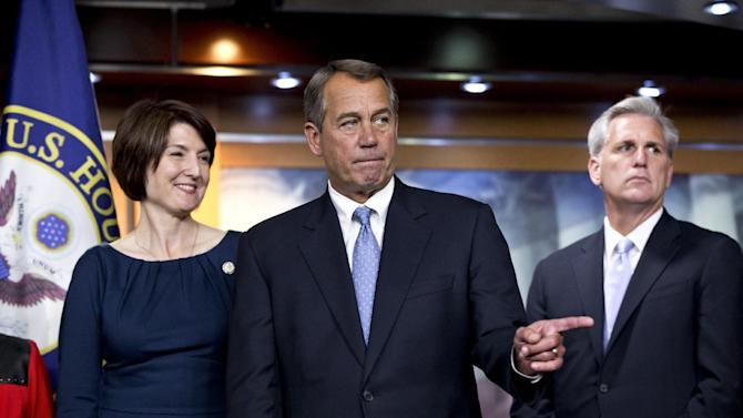 Speaker of the House John Boehner, R-Ohio, center, speaks to reporters after the House Republicans voted for their leadership for the next session of Congress, at the Capitol in Washington, Wednesday, Nov. 14, 2012. House Republicans elevated Rep. Cathy McMorris Rodgers, R-Wash., left, to lead the Republican Conference, with House Majority Whip Kevin McCarthy, R-Calif., right, returning in his role. House Majority Leader Eric Cantor, R-Va., and Boehner were both reelected to their leadership posts.  (AP Photo/J. Scott Applewhite)
