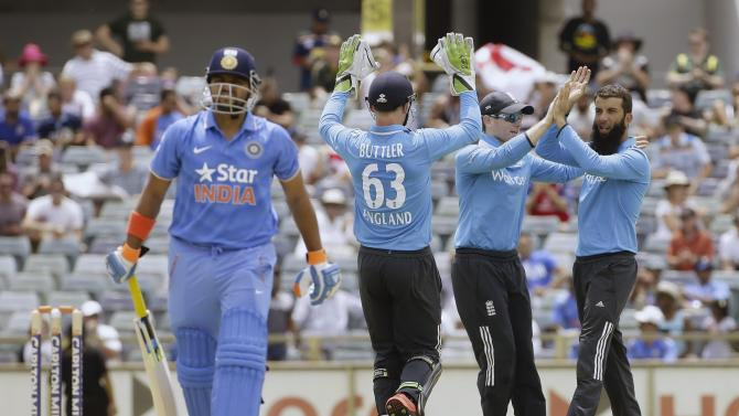 England's Ali celebrates with team mates after taking the wicket of India's Raina during their ODI in Perth