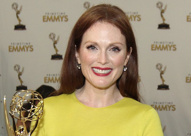 "FILE - In this Sept. 23, 2012 file photo, Actress Julianne Moore, winner Outstanding Lead Actress In A Miniseries or Movie for ""Game Change"", poses backstage at the 64th Primetime Emmy Awards at the Nokia Theatre in Los Angeles. Approximately $127,000 worth of jewelry has been stolen from Moore's New York City brownstone. Police said Thursday, Oct. 4 ,2012, that a necklace, bracelets and watches, some by Cartier, were reported missing. They say the robbery occurred at the home in Manhattan's West Village sometime between June 6 and Aug. 28. (Photo by Matt Sayles/Invision/AP)"