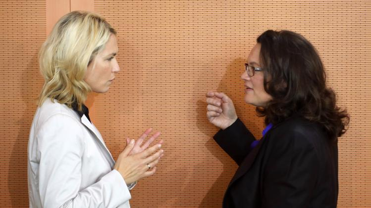 Germany's Family Minister Schwesig talks to Labour Minister Nahles during a cabinet meeting at the Chancellery in Berlin