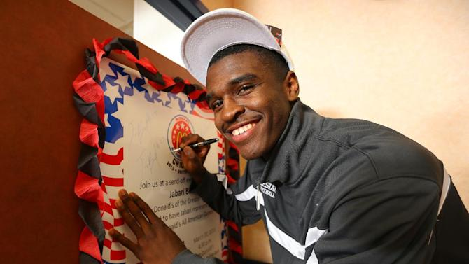 IMAGE DISTRIBUTED FOR MCDONALD'S - Jabari Bird signs a poster at the McDonald's All American Games celebration, hosted by Greater Bay Area McDonald's on Wednesday, March, 20, 2013 in San Pablo, Calif. Three student athletes from the Bay Area were selected among 800 nominees to participate in McDonald's All American Games on April 3 in Chicago. The elite list of prep school stand outs has included Michael Jordan, Kobe Bryant and LeBron James. (Photo by Tomas Ovalle/Invision for McDonald's/AP Images)