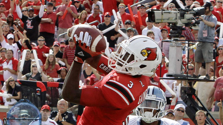 Louisville wide receiver Charles Gaines (7) makes a 32-yard pass for a touchdown during the first half of an NCAA college footbal game against North Carolina in Louisville, Ky., Saturday, Sept. 15, 2012. North Carolina cornerback Tim Scott (7) trails the plays.  (AP Photo/Garry Jones)