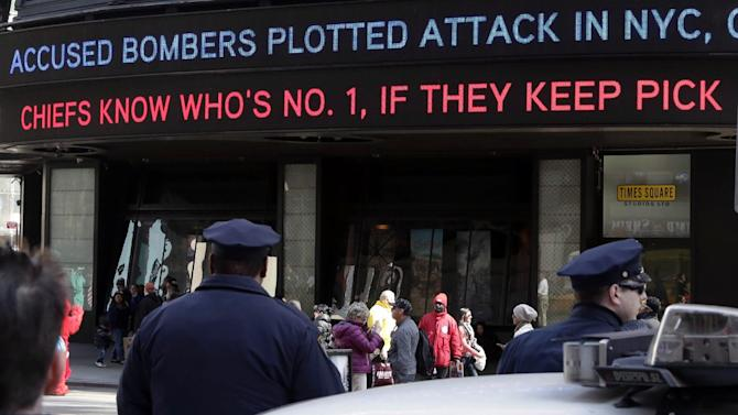 News headlines circle a building in New York's Times Square,  Thursday, April 25, 2013. The Boston Marathon bombing suspects had planned to blow up their remaining explosives in New York's Times Square, officials said Thursday. (AP Photo/Richard Drew)