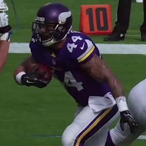 Minnesota Vikings running back Matt Asiata runs up the middle for a 1-yard touchdown