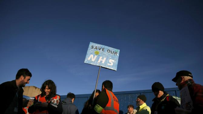 Junior doctors stand on a picket line during a strike outside Manchester University Hospital in Manchester