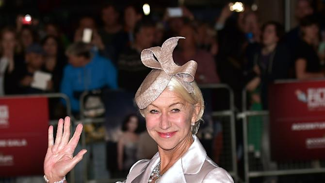 "British actress Helen Mirren waves as she arrives for the European premiere of the film ""Trumbo"" during the BFI London Film Festival in Leicester Square on October 8, 2015"