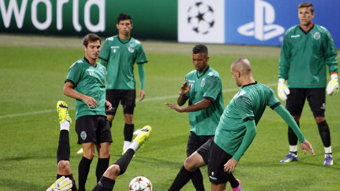 Sporting's players attend a training session on the eve of their Champions League Group G soccer match against NK Maribor at the stadium in Maribor