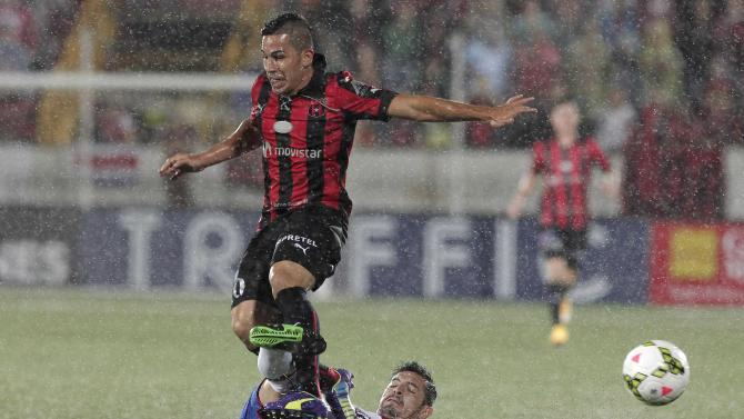 Sanchez of Costa Rica's Liga Deportiva Alajuelense fights for the ball with of Chavez of Mexico's Cruz Azul during their CONCACAF Champions League soccer match in Alajuela City