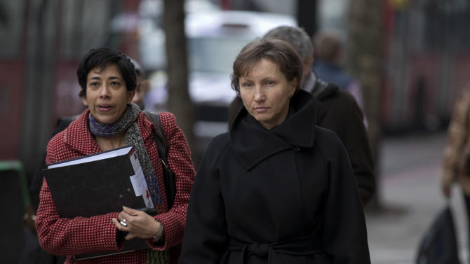 Marina Litvinenko, right, the widow of former Russian intelligence officer Alexander Litvinenko, arrives for the first day of a scheduled two-day Pre-Inquest Review at Camden Town Hall in London, Thursday, Dec. 13, 2012.  Alexander Litvinenko died in a London hospital in 2006, with the rare radioactive substance polonium-210 being found in his body.   (AP Photo/Matt Dunham)