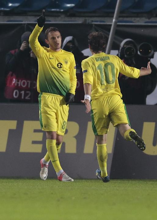 Anzhi's Nikita Burmistrov, left, celebrates his goal against Tromso with teammate Alan Gatagov during the Europa League group K soccer match between Anzhi Makhachkala and Tromso IL at Saturn stadium i