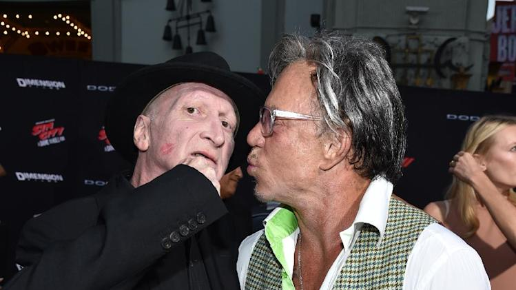 "Writer/director Frank Miller, left, and Mickey Rourke arrive at the ""Sin City: A Dame to Kill For"" premiere presented by Dimension Films in partnership with Time Warner Cable, Dodge and DeLeon Tequila at TCL Chinese Theatre on Tuesday, August 19, 2014, in Los Angeles. (Photo by John Shearer/Invision for The Weinstein Company/AP Images)"