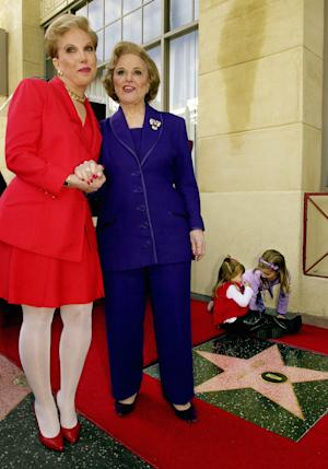"FILE - In this Feb. 14, 2001 file photo, Pauline Friedman Phillips, right, the nationally-syndicated advice columnist best known as ""Dear Abby,"" and her daughter Jeanne Phillips, pose after the dedication of a Dear Abby star on the Hollywood Walk of Fame in Los Angeles.  Phillips, who had Alzheimer's disease, died Wednesday, Jan. 16, 2013, she was 94.  Phillips' column competed for decades with the advice column of Ann Landers, written by her twin sister, Esther Friedman Lederer. Their relationship was stormy in their early adult years, but later they regained the close relationship they had growing up in Sioux City, Iowa. The two columns differed in style. Ann Landers responded to questioners with homey, detailed advice. Abby's replies were often flippant one-liners. (AP Photo/Reed Saxon)"