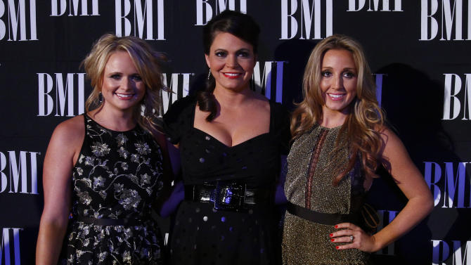Miranda Lambert, left, Angaleena Presley, center, and Ashley Monroe of the Pistol Annies at the 60th Annual BMI Country Awards on Tuesday Oct. 30, 2012, in Nashville. (Photo by Wade Payne/Invision/AP)