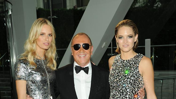 Model Karolina Kurkova, from left, designer Michael Kors and actress Cody Horn attend the 2013 CFDA Fashion Awards at Alice Tully Hall on Monday, June 3, 2013 in New York. (Photo by Evan Agostini/Invision/AP)