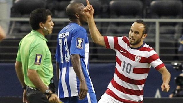 Landon Donovan (R) of the US celebrates his goal against Honduras during their CONCACAF Gold Cup match (Reuters)