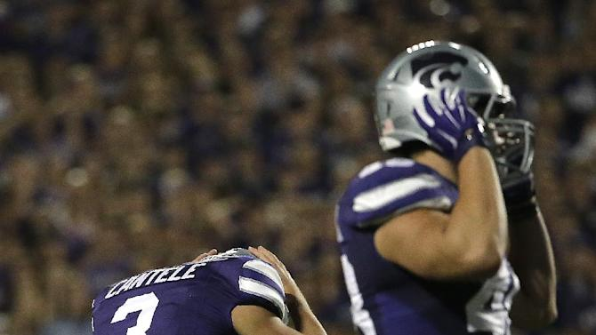 Kansas State place kicker Jack Cantele (3) reacts after missing his third field goal of the game during the second half of an NCAA college football game against Auburn Thursday, Sept. 18, 2014, in Manhattan, Kan