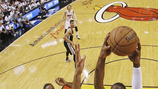 Miami Heat's Dwyane Wade dunks against San Antonio Spurs forward Tim Duncan (21) during the first half of Game 6 in their NBA Finals basketball series, Tuesday, June 18, 2013, in Miami. (AP Photo/Kevin C. Cox, Pool)