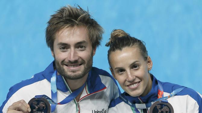 Italy's Cagnotto and Verzotto  pose with their bronze medals after mixed 3m springboard synchronised final at Aquatics World Championships in Kazan