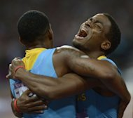 Bahamas&#39; Michael Mathieu (R) and Demetrius Pinder celebrate after winning gold in the men&#39;s 4 x 400m relay final at the athletics event of the London 2012 Olympic Games on August 10, 2012 in London