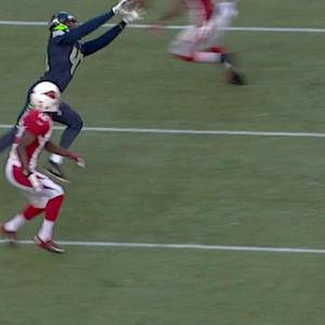 Seattle Seahawks cornerback Byron Maxwell intercepts Arizona Cardinals quarterback Drew Stanton
