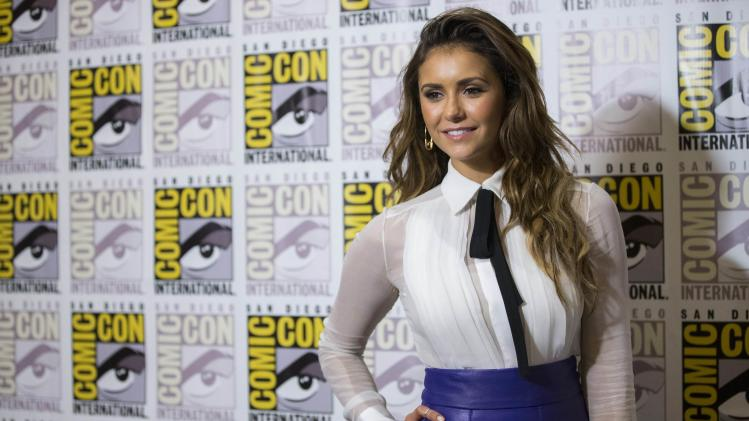 "Cast member Dobrev poses at a press line for ""Let's Be Cops"" during the 2014 Comic-Con International Convention in San Diego"