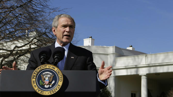 """FILE - In this Feb. 14, 2008, file photo President Bush speaks about the """"Protect America Act"""" outside the Oval Office of the White House in Washington. When the Protect America Act made warrantless wiretapping legal, lawyers and executives at major technology companies knew what was about to happen. They didn't know that its passage gave birth to a top-secret NSA program, officially labeled US-98XN. It was known as Prism. (AP Photo/Pablo Martinez Monsivais, File)"""