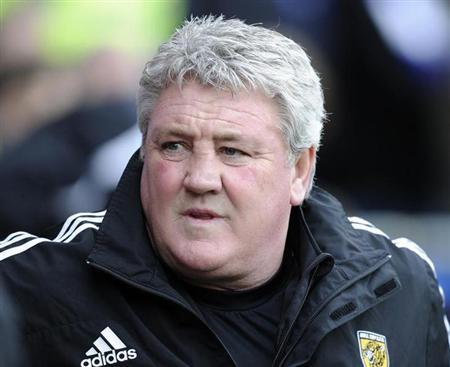 Hull City's manager Steve Bruce during their English Premier League soccer match at Cardiff City Stadium in Cardiff