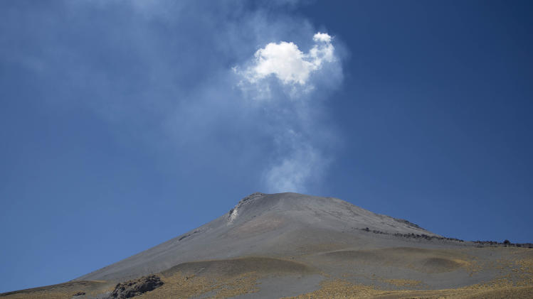 "People who live in nearby villages make their yearly pilgrimage up the slopes of the Popocatepetl volcano in Mexico, Wednesday, March 12, 2014. Every year on March 12, when the sun rises, hundreds of pilgrims head out from the towns of Santiago Xalintzintla, Tlamacas and San Nicolas de Los Ranchos in van and trucks to drive, then walk up the 17,886-foot (5,450-meter) volcano for their daylong celebration. They walk higher up bringing grapes, corn, watermelon, chicken and tequila hoping to appease ""Don Goyo,"" as they call the mountain, from the Nahuatl language. (AP Photo/Eduardo Verdugo)"