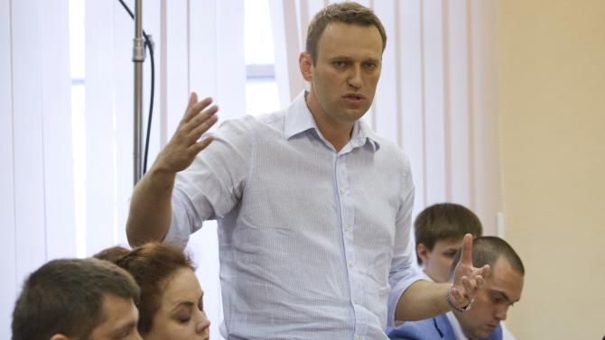Russian opposition leader Alexei Navalny, , speaks in a court in Kirov, Russia on Friday, July 5, 2013. A prosecutor on Friday asked the Russian court to convict Navalny of embezzlement and sentence him to six years in prison. Navalny, who led protests against President Vladimir Putin and exposed alleged government corruption, is accused of heading a criminal group that embezzled 16 million rubles (US$500,000) worth of timber from a state-owned company while working as an adviser to the provincial governor in Kirov in 2009. (AP Photo/Evgeny Feldman)