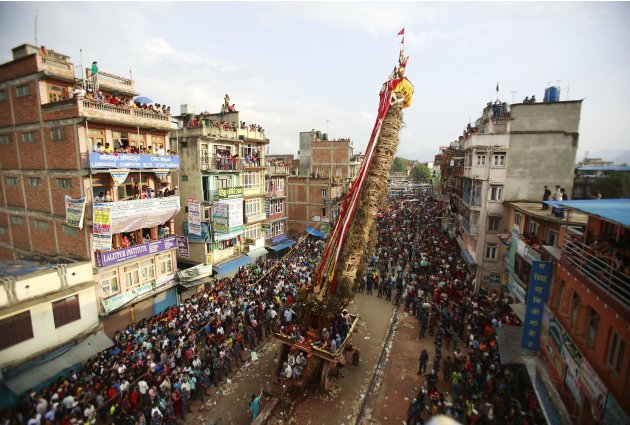 A general view of people surrounding the chariot of Rato Machhindranath is pictured during the chariot festival in Lalitpur