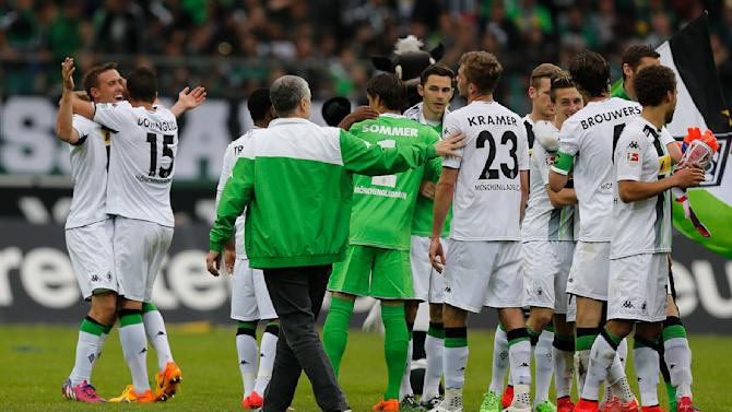Moenchengladbach teammates celebrate with scorer Max Kruse, left, after winning the German first division Bundesliga soccer match between VfL Borussia Moenchengladbach and VfL Wolfsburg in Moenchengladbach, Germany, Sunday, April 26, 2015. (AP Photo/Frank Augstein)