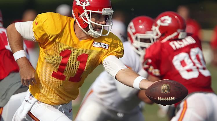 Kansas City Chiefs quarterback Alex Smith hands the ball off during NFL football training camp Tuesday, Aug. 13, 2013 in St. Joseph, Mo. (AP Photo/St. Joseph News-Press, Jessica Stewart)