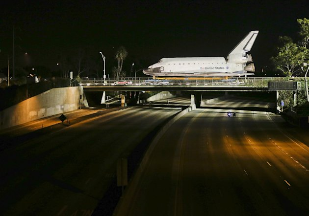 The space shuttle Endeavour makes it&#39;s way down Manchester Blvd. over a closed 405 fwy in Inglewood, Calif., Friday, Oct. 12, 2012. Endeavour&#39;s 12-mile road trip kicked off shortly before midnight Thursday as it moved from its Los Angeles International Airport hangar en route to the California Science Center, its ultimate destination. (AP Photo/Chris Carlson)