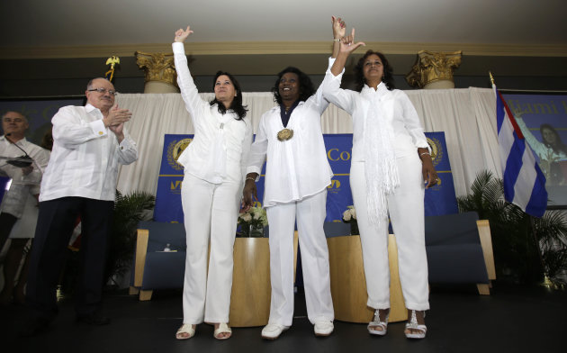 In this Friday, May 20, 2013 photo, Cuban dissidents Ladies in White, from left, Laura Labrada Pollan, Berta Soler, and Belkis Cantillo acknowledge the guests at the Freedom Tower in Miami. MDC Presid