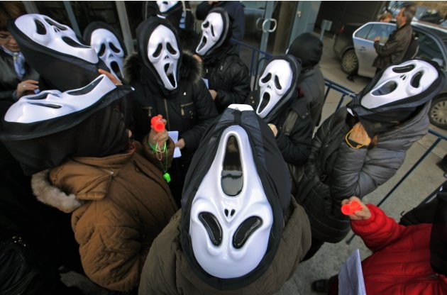 Postal workers wear masks during a protest against their treatment by the management in Bucharest