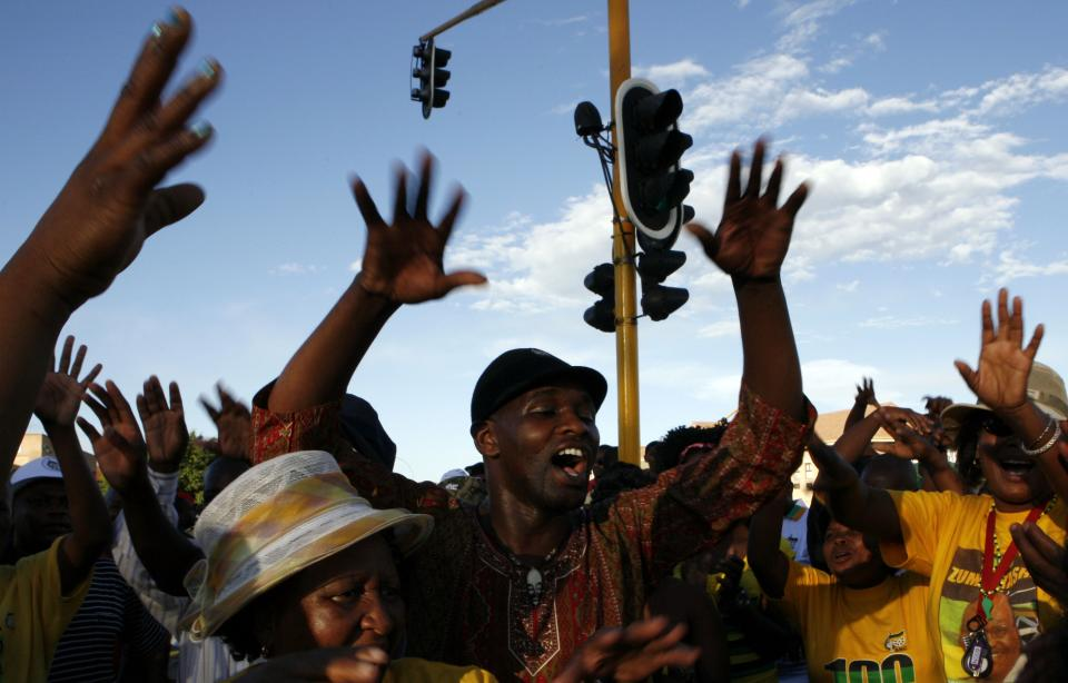 Members of the ruling party African National Congress (ANC) sing and dance during the their elective conference at the University of the Free State in Bloemfontein, South Africa, on Monday, Dec. 17, 2012. (AP Photo/Themba Hadebe)