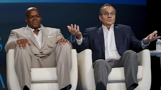 Joe Torre speaks with fellow Baseball Hall of Famer Frank Thomas during a panel discussion at the annual Skybridge Alternatives Conference (SALT) in Las Vegas