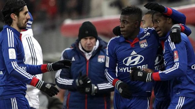 Lyon's Fofana celebrates his goal with team-mates Bisevac and Umtiti during their French Ligue 1 match gainst Valenciennes at the Hainaut Stadium in Valenciennes