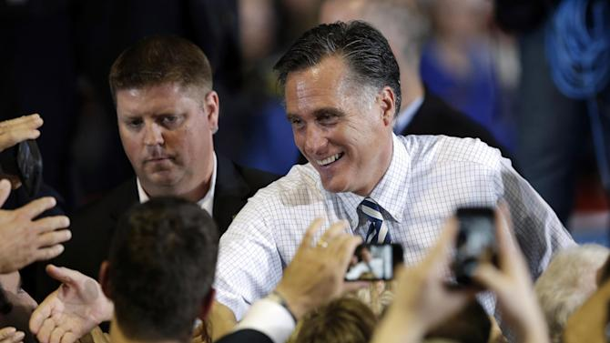 Republican presidential candidate and former Massachusetts Gov. Mitt Romney greets supporters during a campaign stop, Wednesday, Oct. 24, 2012, at the Eastern Iowa Airport in Cedar Rapids, Iowa. (AP Photo/Charlie Neibergall)