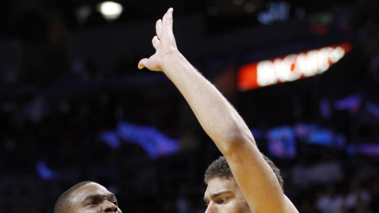 Miami Heat center Chris Bosh (1) goes up for a shot against Brooklyn Nets center Brook Lopez during the first half of an NBA basketball game, Wednesday, Nov. 7, 2012, in Miami. (AP Photo/Wilfredo Lee)
