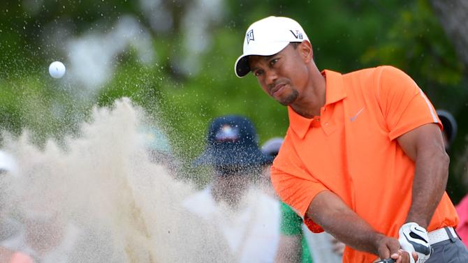 Tiger Woods hits out of a bunker onto the 15th green during the second round of the Arnold Palmer Invitational golf tournament in Orlando, Fla., Friday, March 22, 2013. (AP Photo/Phelan M. Ebenhack)